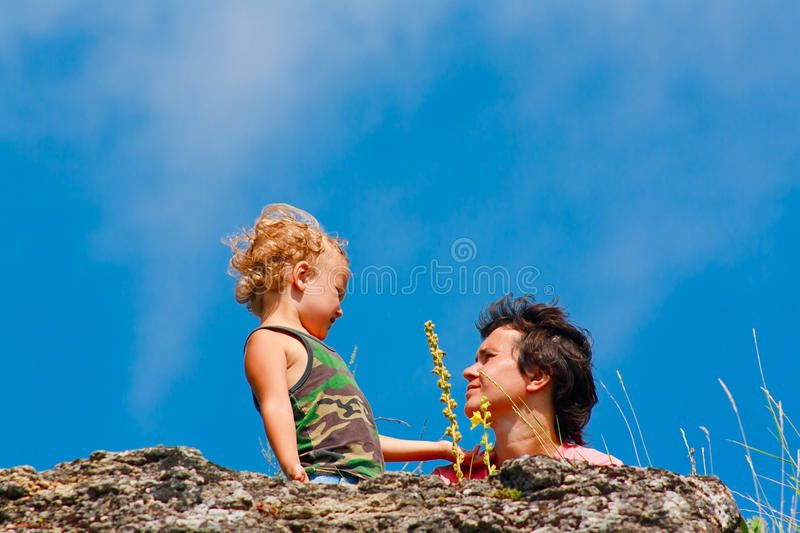 Download Mother And Son On The Rock Royalty Free Stock Photos - Image: 20868308