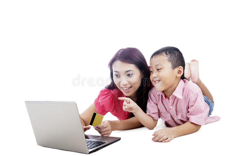 Mother and son shopping online stock images