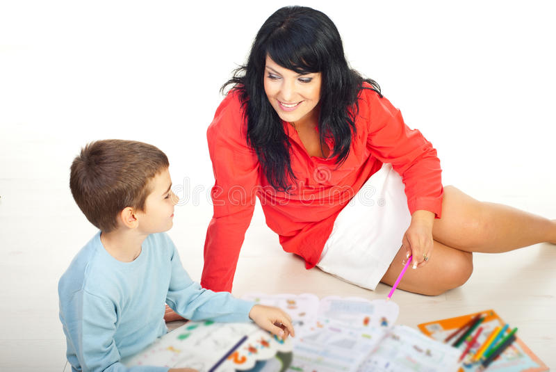 Mother and son sit on floor and talking