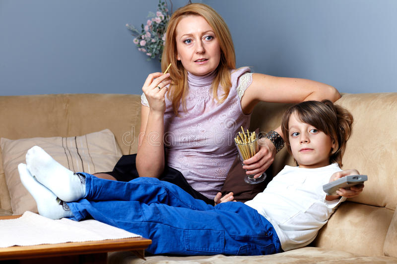 Download Mother And Son Sit On The Sofa And Watch Tv Stock Photo - Image: 23185658