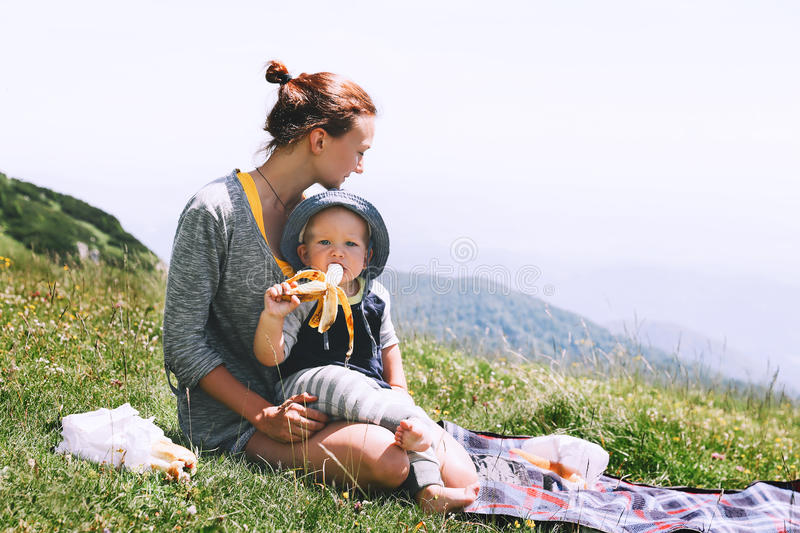 Mother with son spend time on nature in the mountains. royalty free stock photo