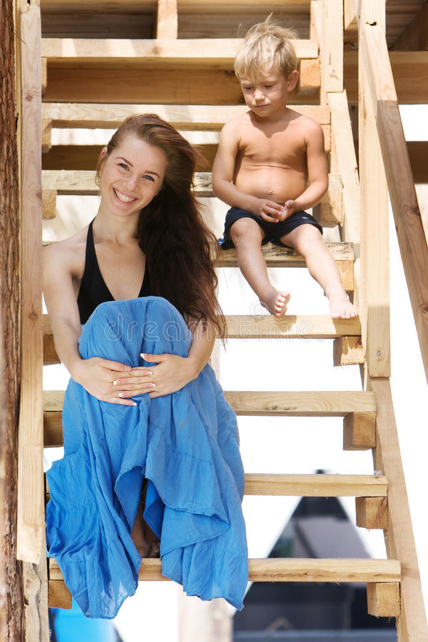 Mother and son on steps