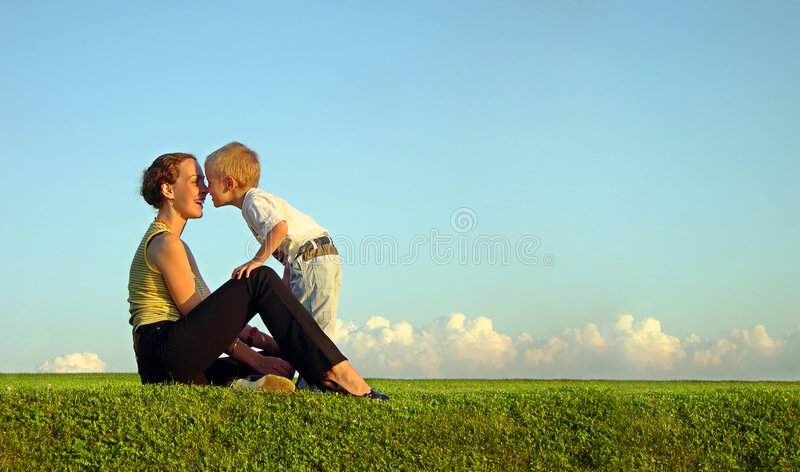 Mother with son on sundown royalty free stock photo
