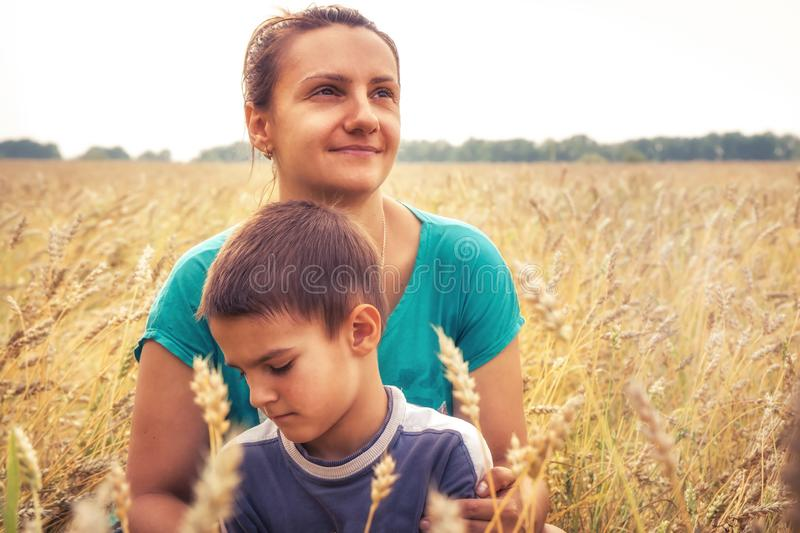 Mother son together portrait rural wheat field during harvesting as farmer family lifestyle royalty free stock photo