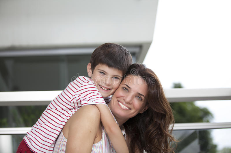 Mother and son. Together smiling at camera outdoors royalty free stock photos
