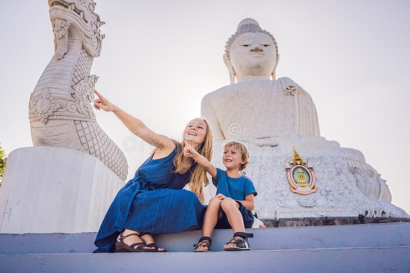 Mother and son tourists on the Big Buddha statue. Was built on a high hilltop of Phuket Thailand Can be seen from a distance royalty free stock images