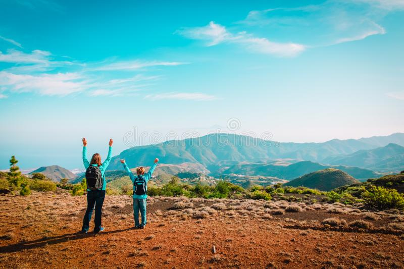 Mother and son travel in nature, family hiking in mountains royalty free stock photos