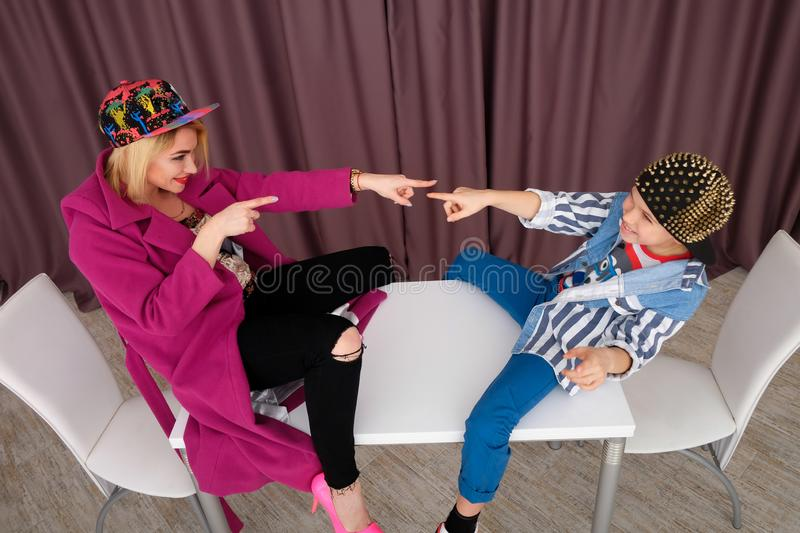 Mother and son tries on clothes and having fun at home royalty free stock image