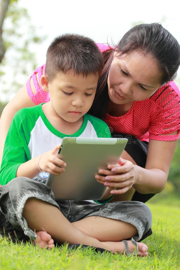 Mother and son using a tablet royalty free stock photo