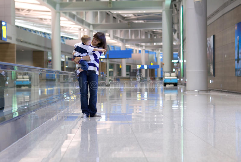 Mother and son waiting for a flight at the airport royalty free stock photography