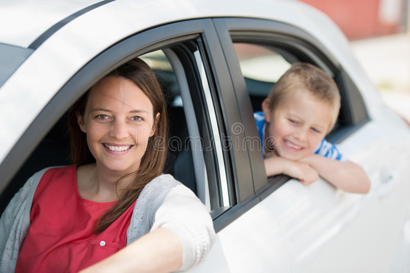 Mother and son. Waiting for something inside the car stock image