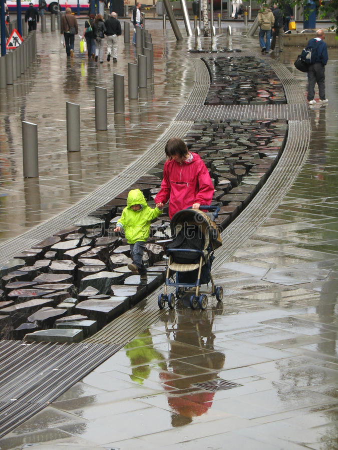 Download Mother And Son Walk In Manchester Under Rain Editorial Stock Image - Image: 20288079