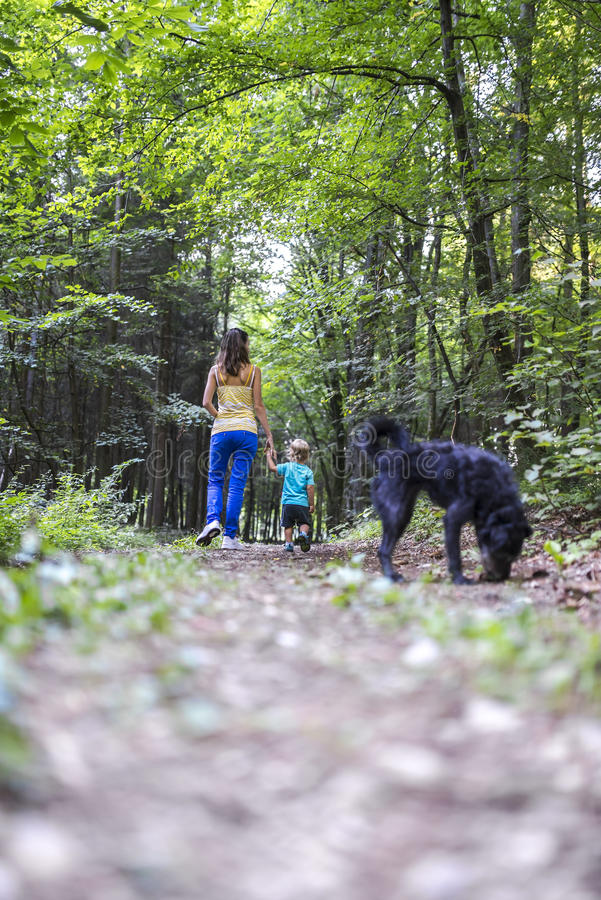 Mother And Son On A Walk With Their Dog Royalty Free Stock Photography