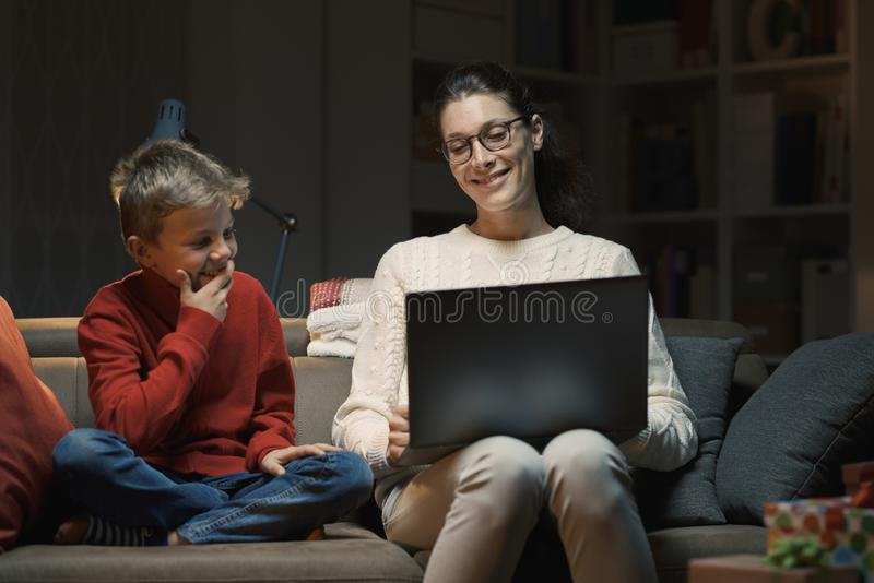 Mother and son watching movies on a laptop royalty free stock photography