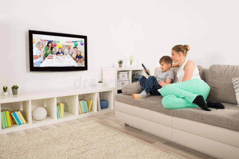 Mother And Son Watching Television At Home royalty free stock photography