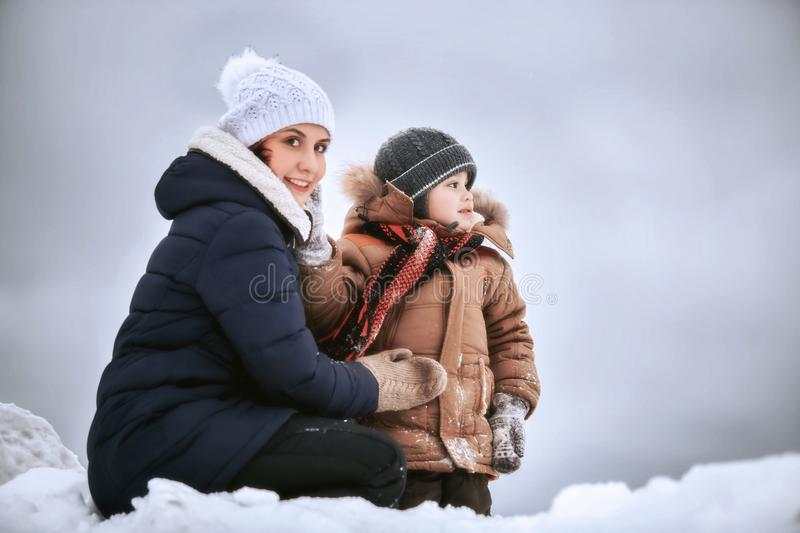 Mother and son on winter walk stock photography