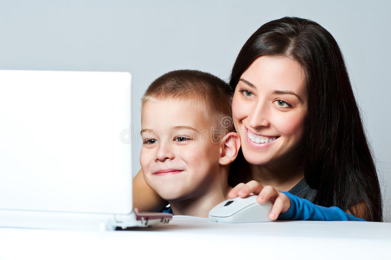 Mother and son working using laptop stock photo