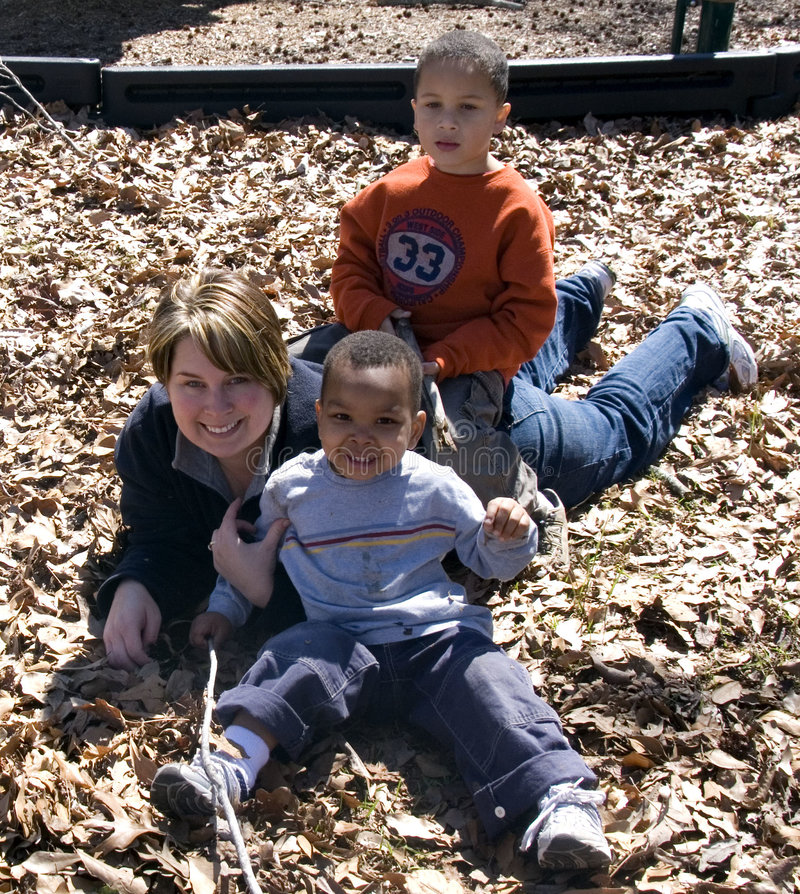 Download Mother and Sons stock photo. Image of leaves, season, outdoors - 4544442