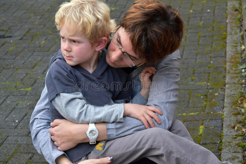 Mother soothes her child royalty free stock image