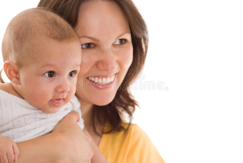 Mother stands and holds the baby royalty free stock image