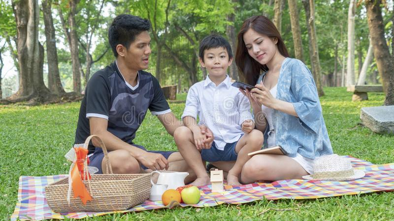 Mother take selfie photo with camera phone with father and kid i stock photo