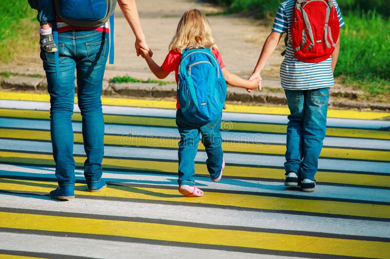Mother taking kids to school or daycare. Mother taking kids - boy and girl- to school or daycare stock photos