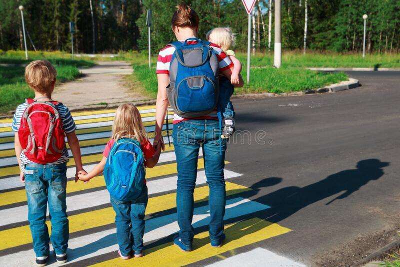 Mother taking kids to school or daycare royalty free stock photo