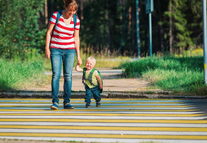 Mother taking little baby girl to school or daycare royalty free stock images