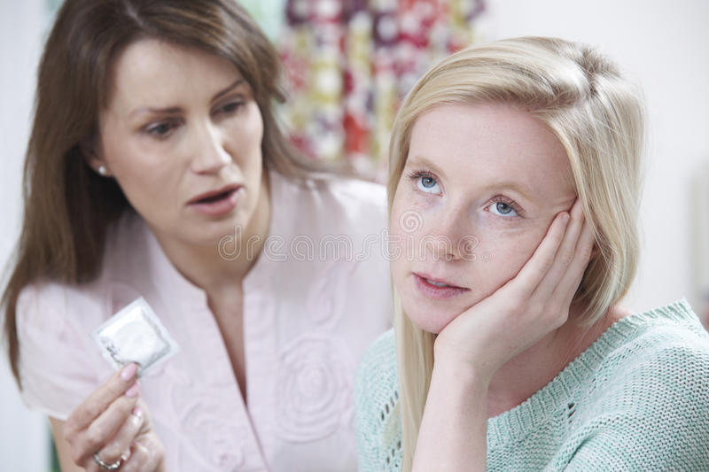 Mother Talking To Teenage Daughter About Contraception. Angry Mother Talking To Teenage Daughter About Contraception stock image