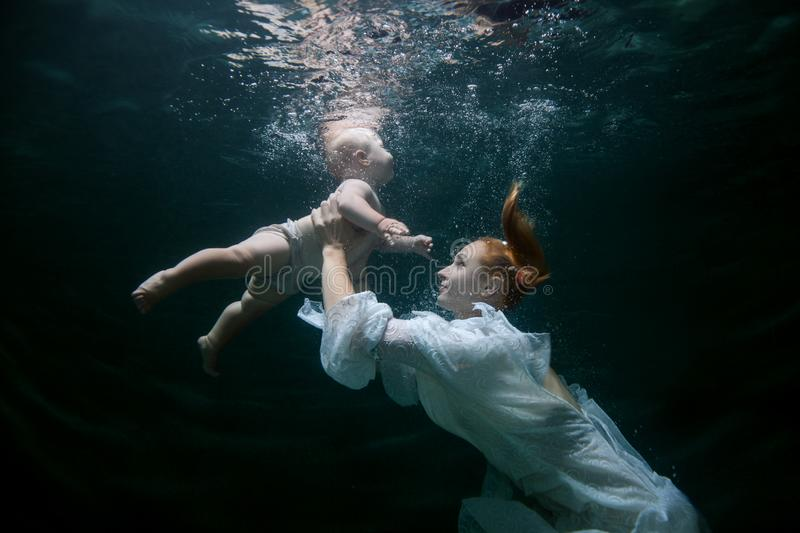 Mother teaches the baby to dive. stock image