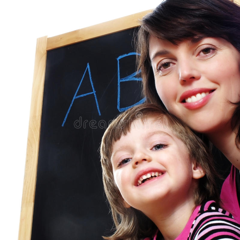 Mother teaches daughter to read royalty free stock photo