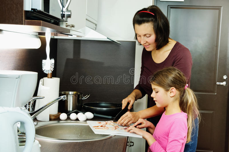 Mother teaches her daughter royalty free stock photo