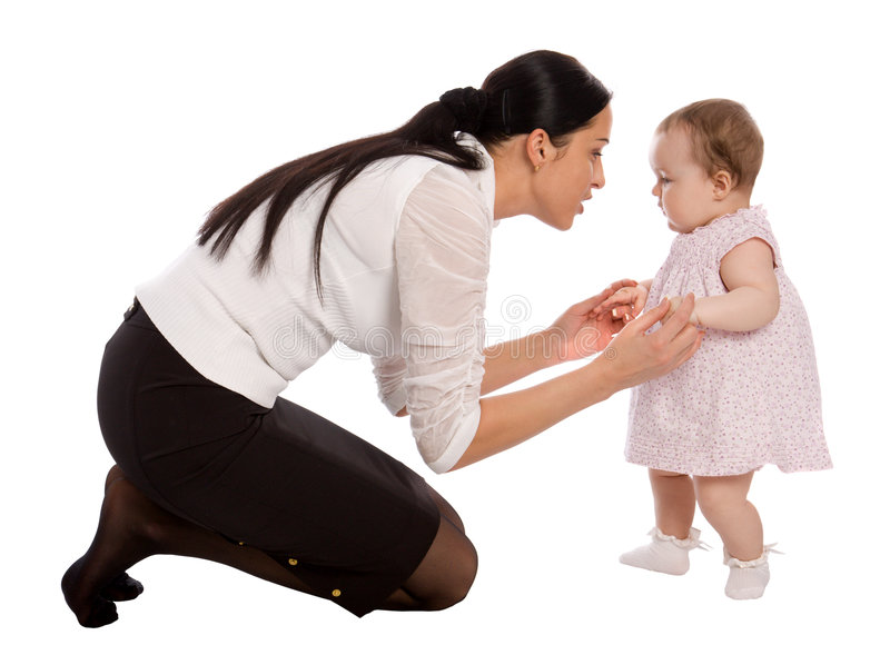 A mother teaches his daughter to walk royalty free stock photography