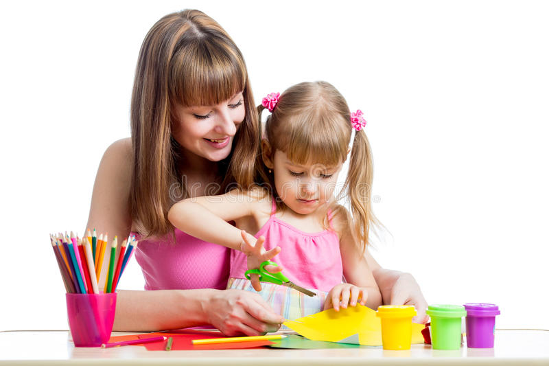 Mother teaches kid to do craft items. Mother teaches preschooler kid to do craft items. DIY concept royalty free stock photos
