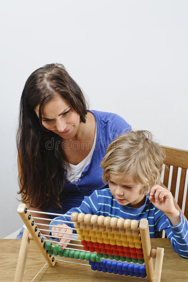 Mother teaches son stock photography