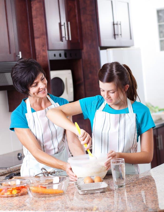 Mother Teaching Daughter Baking Royalty Free Stock Photo