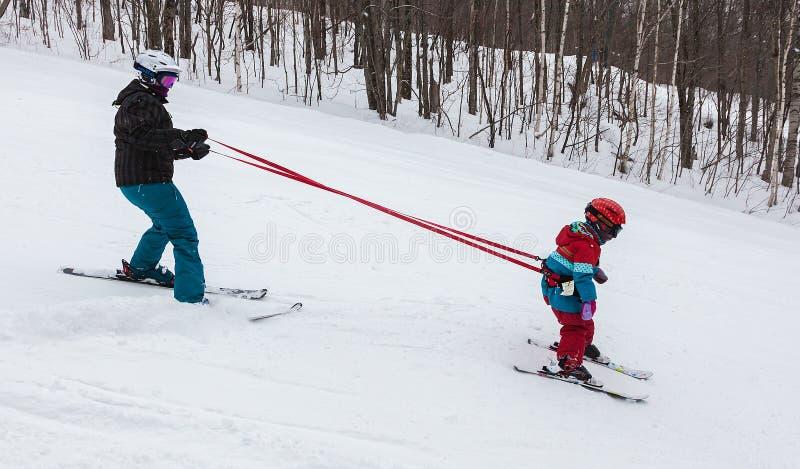 Mother Teaching Daughter to Ski at Mont-Tremblant Ski Resort royalty free stock photo