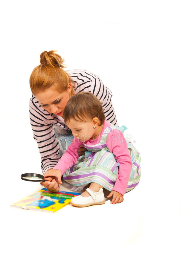 Mother teaching her daughter royalty free stock photo