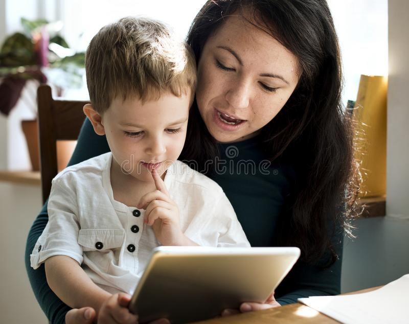 A mother teaching her son his assignment royalty free stock image