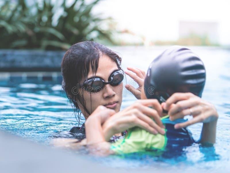 Mother teaching son to swim royalty free stock photo
