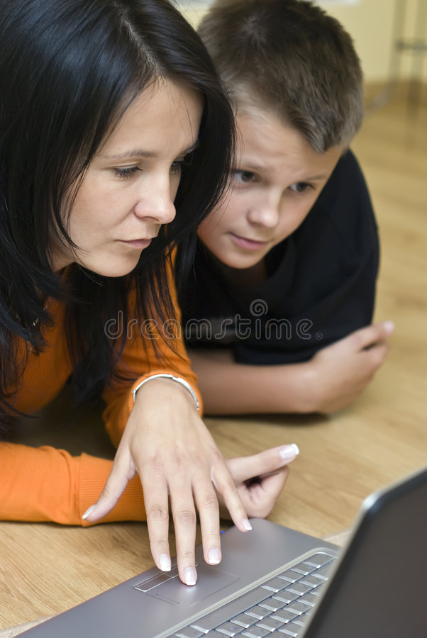 Mother and teenage boy with laptop royalty free stock photos