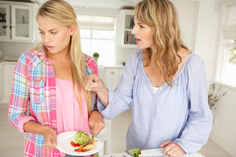 Mother and teenage daughter arguing stock photos