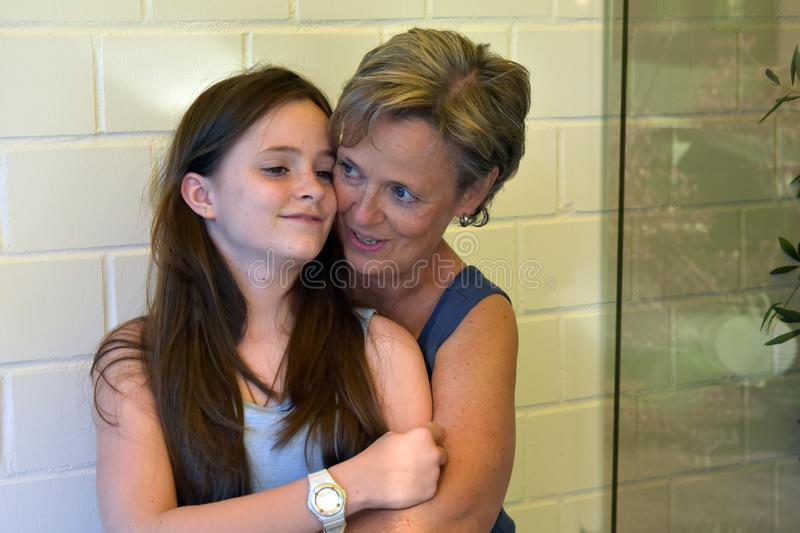 Mother and teenage daughter. Best friends hugging each other stock images