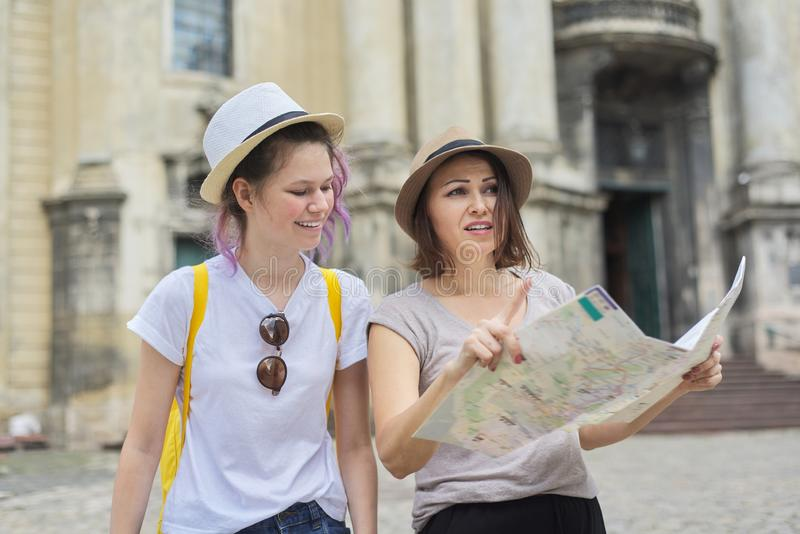 Mother with teenage daughter travel, women with map royalty free stock images