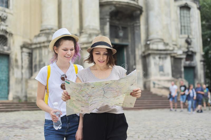 Mother with teenage daughter travel, women with map royalty free stock photo