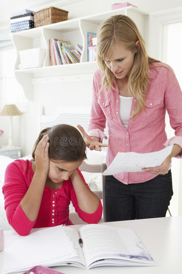 Mother Telling Daughter Off For Bad School Report stock image