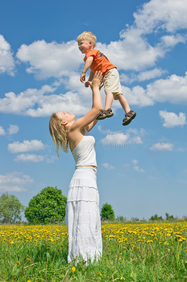 Mother throwing son into the air stock photo