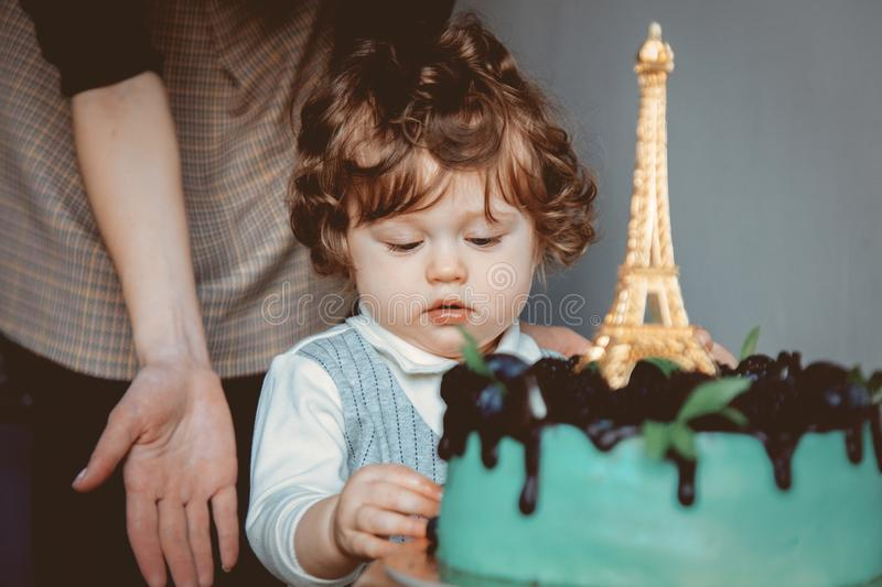 Mother and toddler boy with his first cake on Birthday. Cake is with Eiffel tower on it stock images