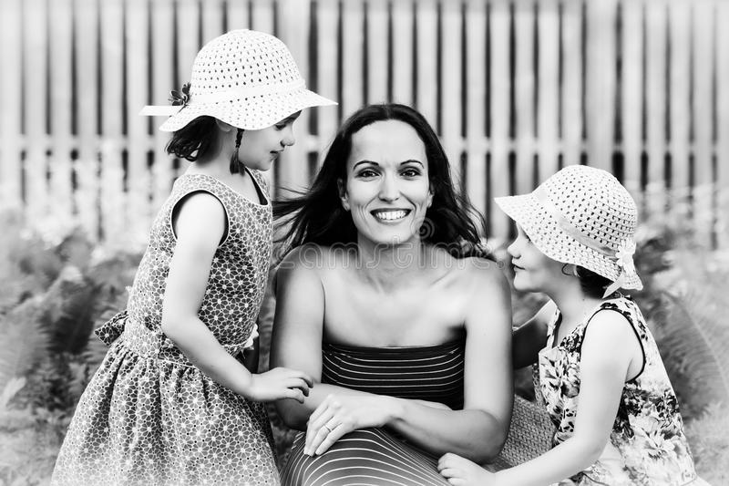 Mother Together with her Daughters - Black and White stock image
