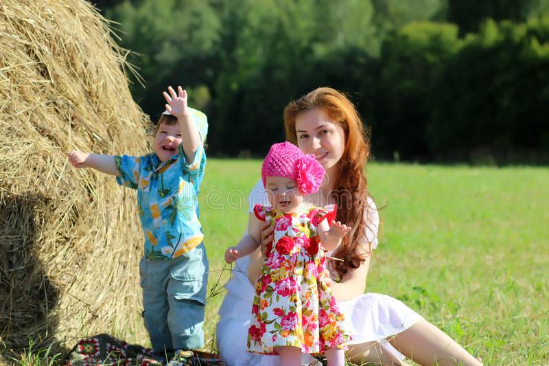 Mother with twins in field royalty free stock photos